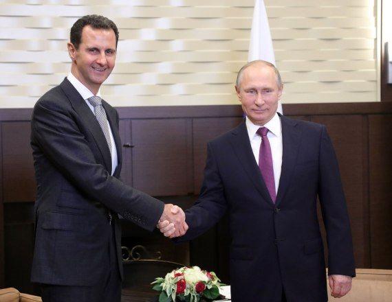 נשיא רוסיה ולדימיר פוטין ונשיא סוריה בשאר אל אסד