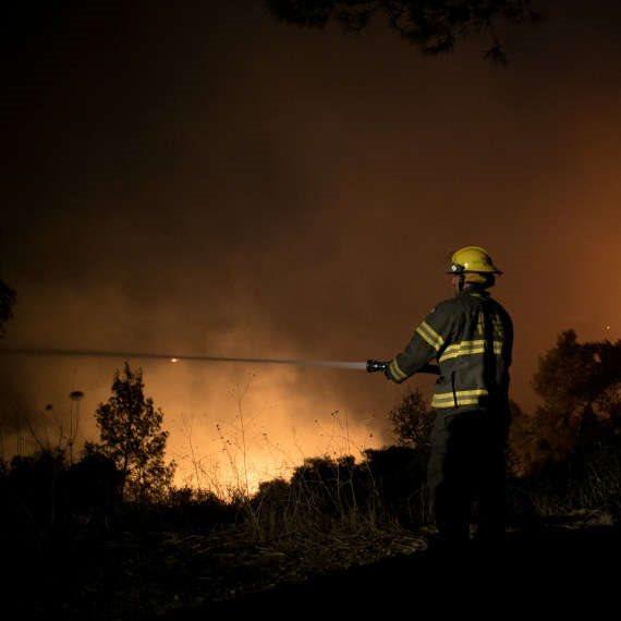 מכבי האש במהלך שריפה (ארכיון)